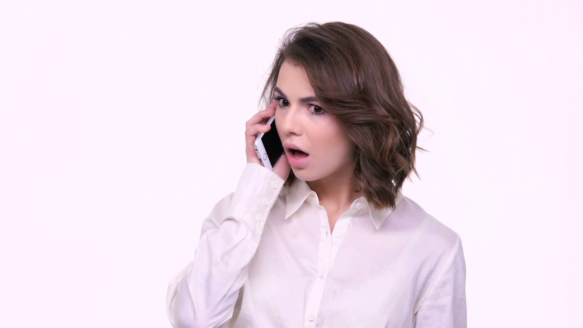 Woman Talking On Phone Png - Shocked young woman talking on mobile phone isolated over white ...