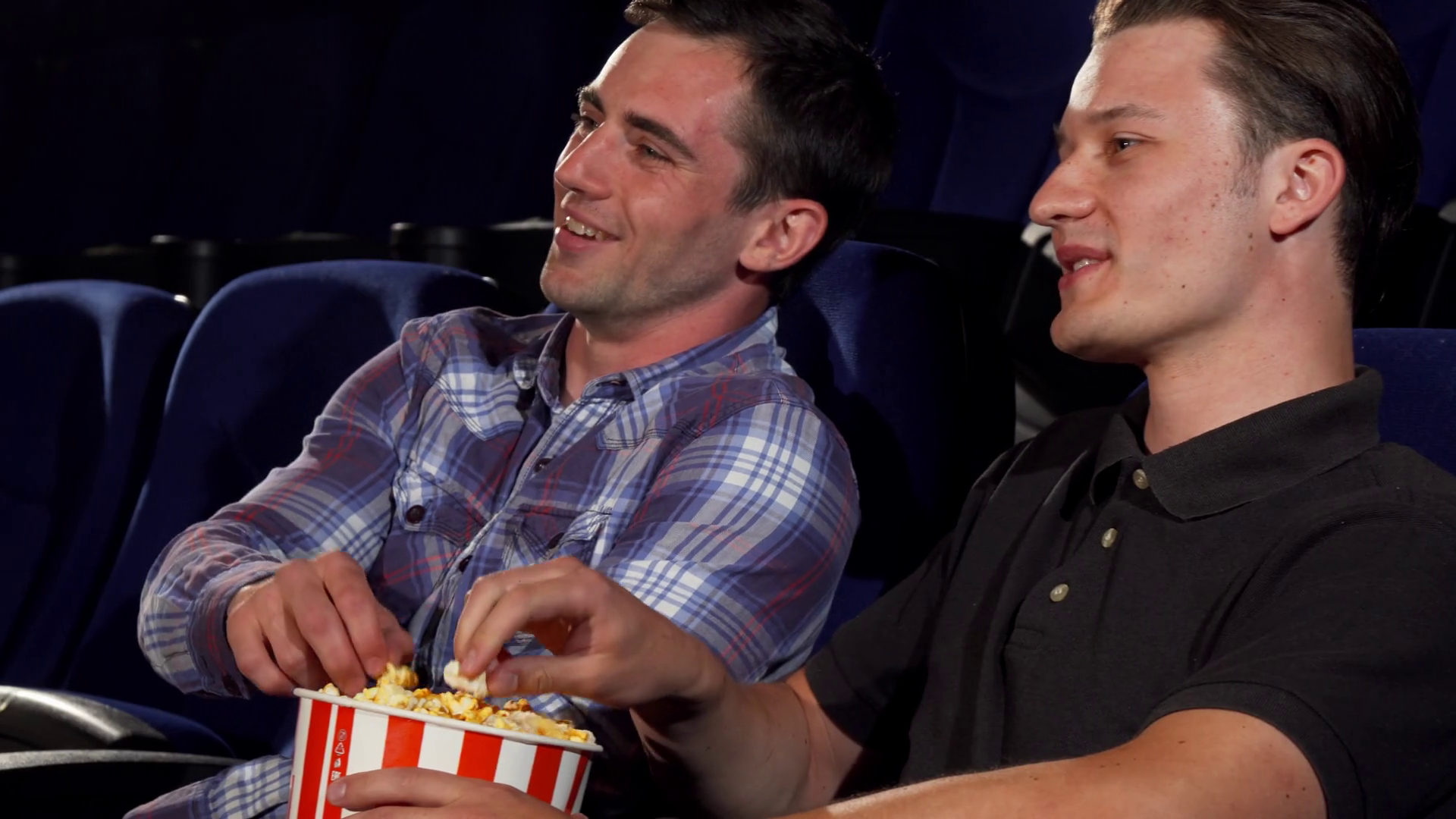 Two People Relaxing Png - Sliding shot of two young cheerful male friends eating popcorn ...