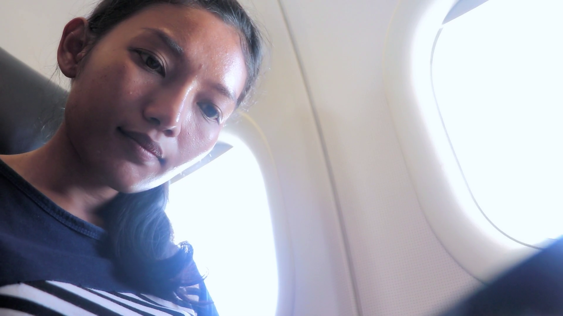 Woman Reading On Plane Png - Woman is looking at a news while flying a plane. The passenger on ...